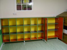 Brightly coloured pigeon hole storage with a cupboard attached. Bright and appealing for the small ones in the nursery!