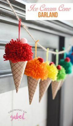 Make yarn pom poms and paper cones in to a bright and colorful DIY ice cream cone garland. These are great for an ice cream birthday party or just a fun summer decoration.