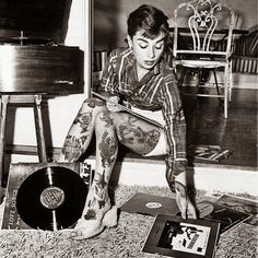 Audrey Hepburn at home, playing her vinyls, and looking rock and roll!