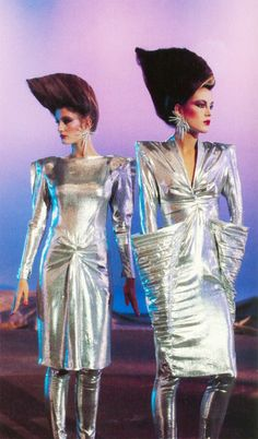 Shoulder-padded models with big hair on a surreal landscape - it doesn't really get more 80s than this, especially the straight arm pose of the model on the left.