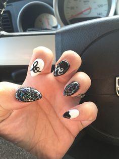 Almond shaped nails Valentine's Day design black white glitter