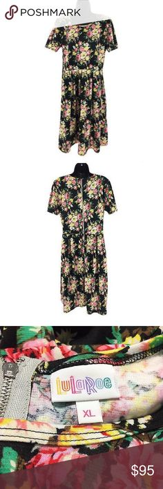Lularoe Dress XL Floral Multicolored Pockets In great condition. Material: spun Polyester and spandex. Measurements laying flat: shoulder to shoulder: 15 inches. Pit to pit: 20 inches. Waist: 17 inches. Hip: 25 inches. Length: 40 inches. Sleeve: 9 inches. LuLaRoe Dresses
