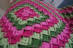 Beautiful Bavarian crochet baby blanket in pink and green