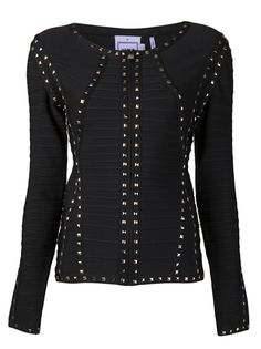 I love the lines on this fitted zip-front black studded jacket.