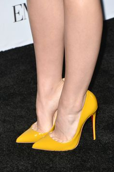 Yellow pumps, arches, and toe cleavage