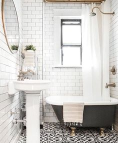 Black, white and gold bathroom. Subway and cement tile.