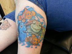 never mind the Finding Nemo tat...i love the Garfield & Pooky tat on her other thigh! :)