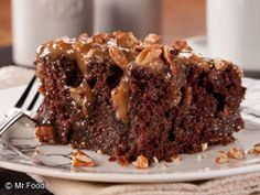 """Our Ooey Gooey Caramel Pecan Poke Cake starts with a packaged cake mix, but it still has that old-fashioned, """"from-scratch"""" taste that everyone craves."""