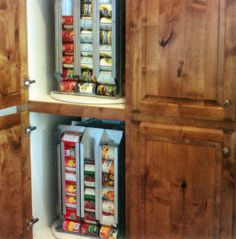 For the dumbest part of a home: the corner cabinet.  This lazy susan food storage lets you spin for the cans you need.  Love it.  Want it.  Covet it....