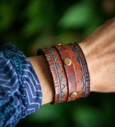 DIY Leather Cuff Bracelet decorated with a pyrography tool, rivets and acrylic leather paint