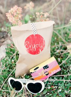 #cameras, #favor-bags, #birthday, #sunglasses, #heart, #party-favor  Photography: Cassidy Brooke - cassidybrooke.com/  View entire slideshow: Fabulous Favors on http://www.stylemepretty.com/collection/303/