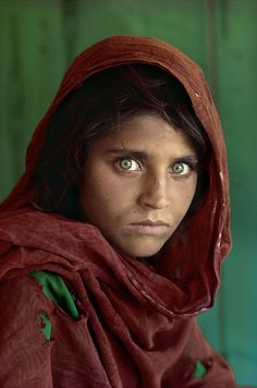 One of the Most Famous Portraits of All Time. Afghan Girl by Steve McCurry. This photo was used on a famous cover of National Geographic Magazine. The identity of the girl was unknown until 2002. Her name is Sharbat Gula and she was 13 years old at the time. Her parents had died in the Soviet bombing of Afghanistan and she was living in a refugee camp in Pakistan.