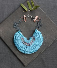 Flickr photo, tinctory, some fasciniating smocked jewelry examples. http://www.flickr.com/photos/tinctory/6226901888/in/photostream/