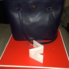 100% Authentic Coach Bag w/ box! 13.5 x 10.75 x 5 midnight black authentic Coach tote bag. Brand New with tags. Never used! With box! Coach Bags Totes