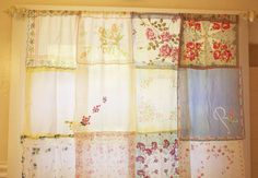 Vintage hanky curtain. I'm thinking maybe the shower curtain in little girl's bathroom?