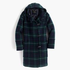 A supercozy silhouette featuring deep front pockets, a side toggle closure and an oversized hood. Plus, warm wool with an oversized plaid pattern.