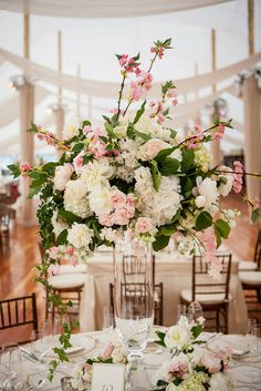 peony, rose, sweet pea and cherry blossom arrangement by Sayles Livingston