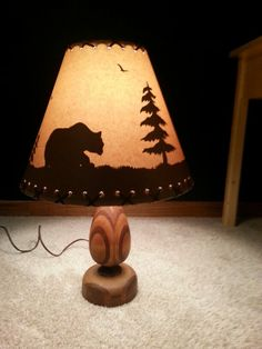 Lamp my Dad made about 40 years ago.   My Hubby rewired it and I found this cute shade at Lowe's.   It will have a place of honor at the lake this summer.
