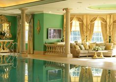 Interior infinity edge pool. An indoor pool is a long time dream of mine but definitely not with these colors. picky, picky. lol
