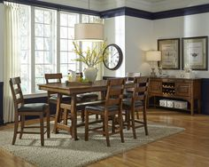 The Ozark dining collection showcases the beauty of mango wood. The rich tobacco finish highlights the wood grain. Set includes 40
