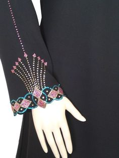 Pink motif abaya sleeve   for more:  http://pakifashion.com/category/abaya/