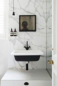 marble + black details | Toorak residence designed by Hecker Guthrie via the design files.