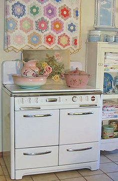 i just love that quilt above the lovely old vintage stove!