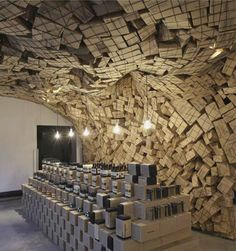 Giant net of cardboard boxes at Aesop pop-up shop - DO: with Bright coloured boxes - feature wall or area at an event
