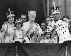 King George VI and Queen Elizabeth, the Queen Consort, make an appearance after their coronation ceremony with Queen Mary and the young princesses Elizabeth and Margaret on the Buckingham Palace balcony in 1937. The Queen Consort is wearing the coronation crown that includes the famous 106 carat Koh-i-Noor Diamond.