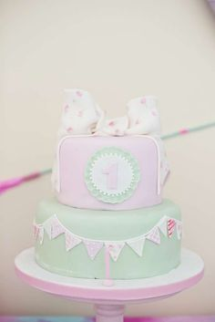Pink and mint cake at an Indian 1st birthday party! See more party planning ideas at CatchMyParty.com!