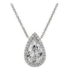 Timeless 3 carat E/VS2 Pear-Shaped Diamond Necklace | From a unique collection of vintage drop necklaces at http://www.1stdibs.com/jewelry/necklaces/drop-necklaces/
