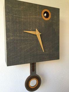 Modern Quartz Cuckoo Clock with working and chirping Cuckoo bird and swinging…