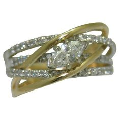 0.70 cttw. Diamond Ring in 14 k tt https://www.goldinart.com/shop/rings/diamond-rings/0-70-cttw-diamond-ring-14-k-tt #DiamondRing, #Marquise