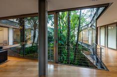 Gallery of LLM House / Obra Arquitetos - 47 Biophilic Architecture, Interior Architecture, Future House, My House, Atrium Garden, Metal Beam, Concrete Retaining Walls, Concrete Interiors, Container Buildings