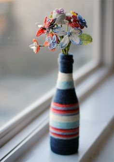 yarn wrapped bottle vase (with beaded flowers)