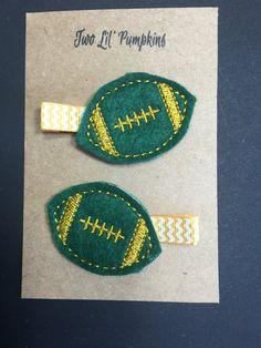 This football feltie hair clip is the perfect addition to any girls football outfit! The feltie comes securely attached to a partially lined 1 3/4