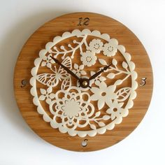 Adorable clock...love the wood and the Doilie look  Modern Decorative Wall Clock  Kirie 02 by decoylab on Etsy, $84.00