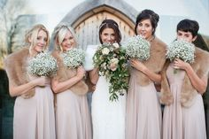 Lace Enzoani Isla Gown for a Winter Wedding at Cripps Stone Barn with Bridesmaids in Mink Jaques-Vert Dresses from John Lewis & Fur Stoles from Zara with Gypsophila Bouquets. Groom in Ben Sherman Suit & Church's Footwear Shoes. Vintage Wedding Flowers, Wedding Fur, Blush Wedding Flowers, Winter Wedding Flowers, Bridesmaid Flowers, Long Bridesmaid Dresses, Chic Wedding, Gold Wedding, Table Wedding