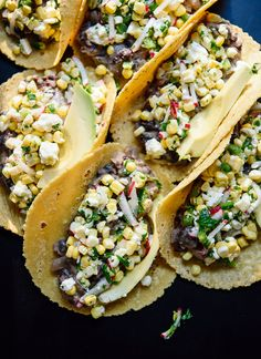 These hearty summer tacos feature lime-marinated fresh corn, jalapeño and radishes on top of warm black beans. Feta and avocado make these complete! Recipe yields 10 tacos (a lot! Mexican Food Recipes, Vegan Recipes, Cooking Recipes, Fall Recipes, Delicious Recipes, Sweet Corn Recipes, Summer Vegetarian Recipes, Dinner Recipes, Spinach Recipes