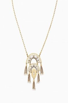 """Hand applied sequin detail and delicate chain tassels form this intricate pendant necklace. Inspired by the brilliant patterns of Mexican papel picado (perforated paper) this style adds fun movement to any look.    Vintage gold plating 26 1/2"""" with 5"""" extender Lobster Clasp Closure"""