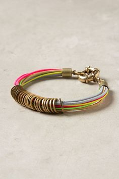 fd0f6b38e5a4 Anthropologie's Vivid Wrung Bracelet - brassy washers on neon strands. I  could do this with