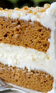 Pumpkin Cheesecake Cake Recipe ~ two layers of delicious pumpkin cake with a creamy cheesecake center. Frosted with cream cheese frosting!