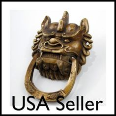 i want this door knocker.  and it's sold out, why are all other foo dog knockers not nearly as cute?