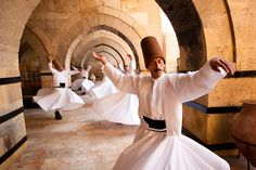 Whirling dervishes perform, Sufi Muslims who dance as a part of their mysticism.