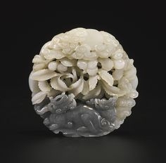 A RARE BLACK AND WHITE JADE 'RHINOCEROS' PLAQUE MING DYNASTY