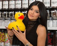 Reality star: The Keeping Up With The Kardashians star held a rubber duck at the new store and restaurant