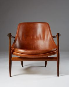 Rosewood and original natural leather. H: 71 cm/ 28'' W: 79 cm/ 31'' D: 76 cm/ 30'' Seat height: 35 cm/ 13 3/4'' Initially known as the U-56, this armchair was renamed after Queen Elizabeth II purchased a pair in 1958. Now more commonly known as the Elizabeth, the chair's rosewood and leather version is among the most rare and valuable to collectors of Kofod-Larsen's work. Provenance: private Danish collection. Literature: Grete Jalk, e...