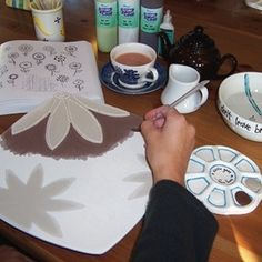 painting pottery and drinking tea.