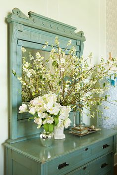 "A trademark of shabby chic décor is utilizing furniture in spaces they aren't traditionally meant for. This large turquoise dresser makes a great entryway piece…with plenty of ""hidden"" storage."