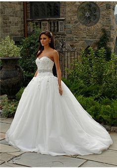 Strapless Jovani ball gown with a train features a lace top bodice with an embellished belt design at the midsection and a sweetheart neckline